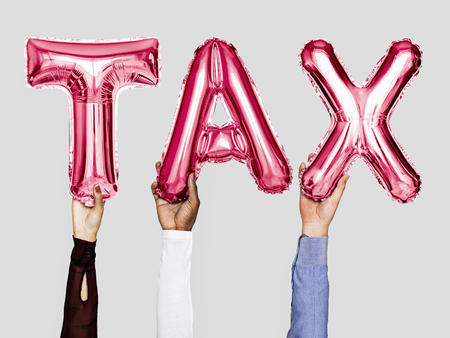 Hands showing tax balloons word