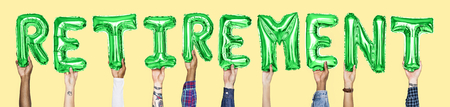 Green alphabet balloons forming the word retirement