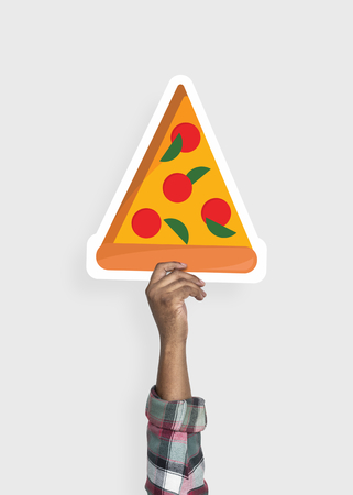 Hand holding a slice of pizza cardboard prop