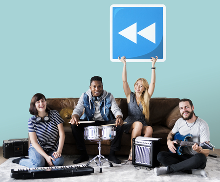 Band of musicians holding a rewind button icon Stock Photo - 112892966