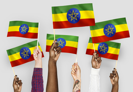 Hands waving flags of Ethiopia Stock Photo