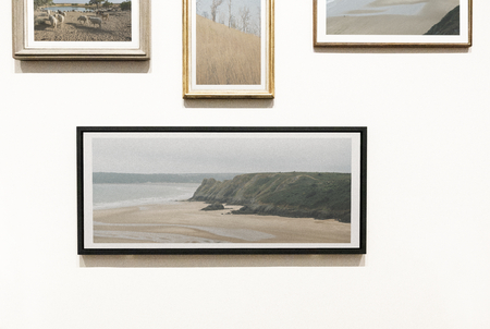 Collection of art pieces on a wall