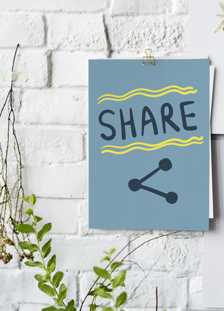 Share written on a paper poster on white wall