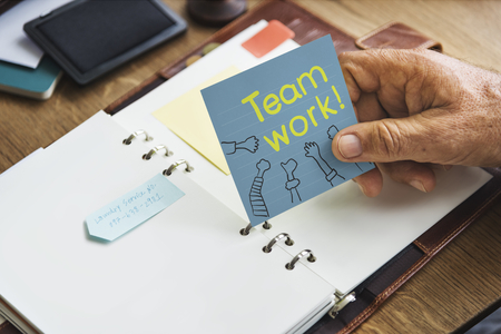 Teamwork written on a  sticky note