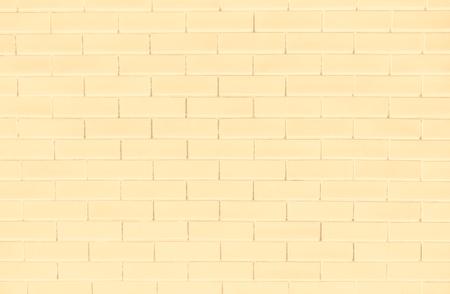 Yellow brick wall textured background