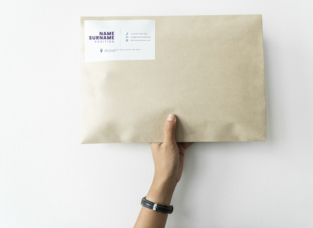 Woman holding up a package mockup