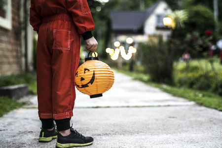 Little boy holding a Halloween lantern