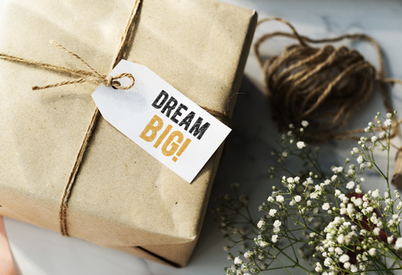 Present box with Dream big tag Фото со стока
