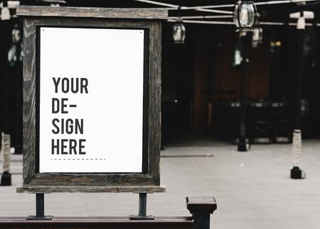 Rustic wooden signboard mockup at a restaurant