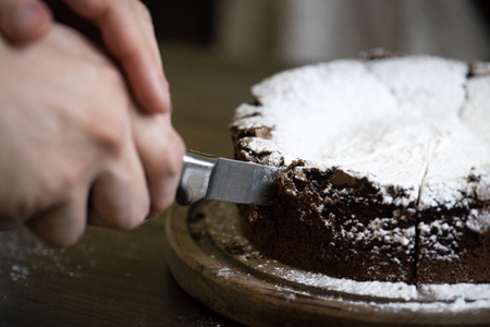 Patisserie slicing chocolate fudge cake photography recipe idea 写真素材