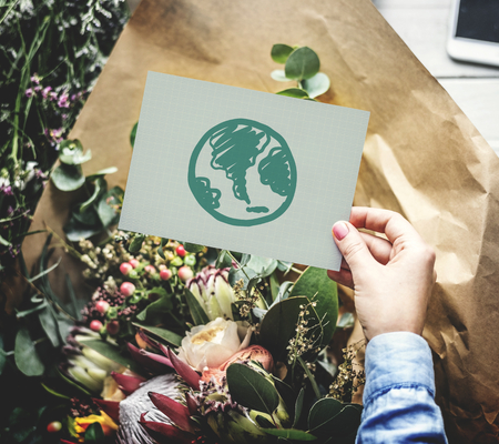 Flowers and a green earth drawing on a card Stock fotó