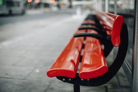 Empty red bench in the city Stock Photo