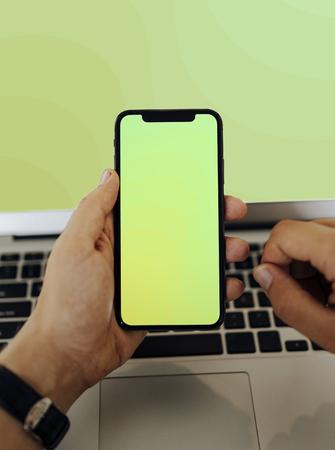 Closeup of a man using a mobile phone