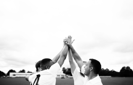 Group of football players doing a high five