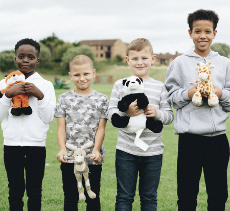 Group of young boys caring about animal rights