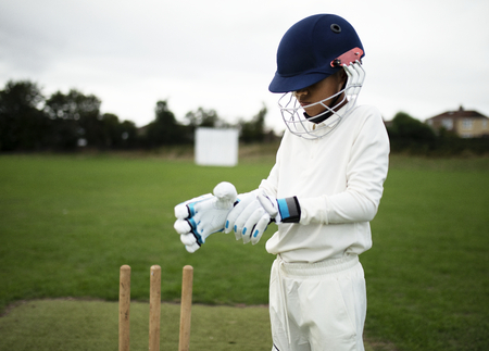 Cricket player getting ready to play Stock Photo