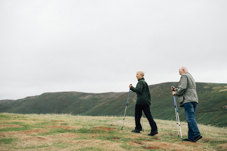 Active seniors with trekking poles