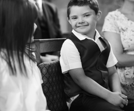 Cute little boy waiting for the bride to arrive