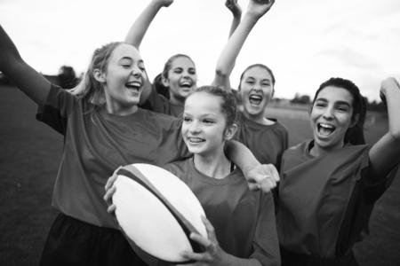 Energetic female rugby players celebrating Reklamní fotografie
