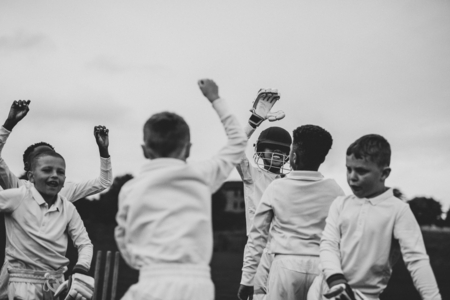 Young cricket players cheering to their victory