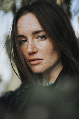 Portrait of a woman with freckles Foto de archivo
