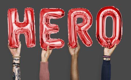Hands showing hero balloons word Stockfoto - 113917817