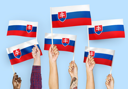 Hands waving flags of Slovakia 스톡 콘텐츠