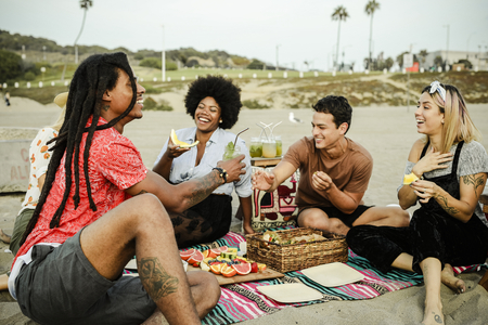 Friends having a picnic at the beach