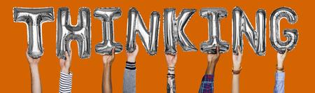 Silver gray alphabet helium balloons forming the text thinking Stok Fotoğraf