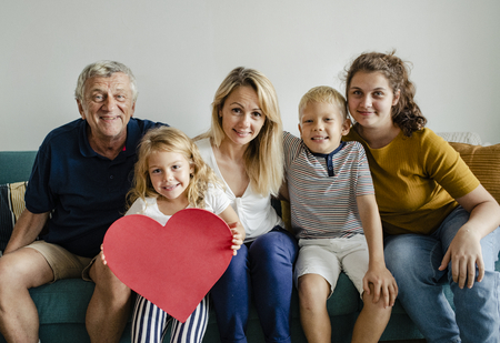 Family showing a red heart symbol 写真素材