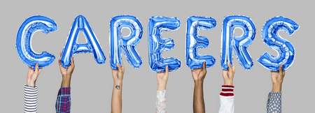 Hands holding careers word in balloon letters Imagens