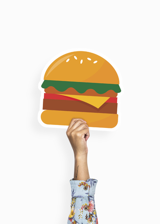 Hand holding a burger cardboard prop Stock Photo