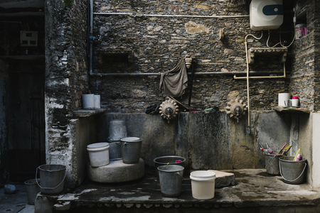 Buckets at a washing area Stock Photo