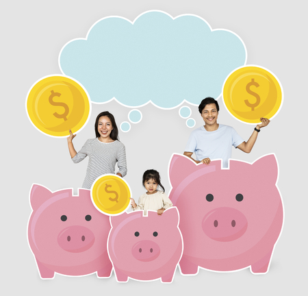 Happy family with savings in piggy banks Banco de Imagens