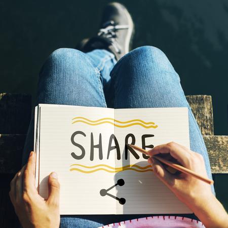 Woman writing Share on a notebook 版權商用圖片