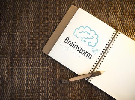 Brainstorm written on a notebook