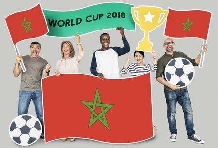 Diverse football fans holding the flag of Morocco