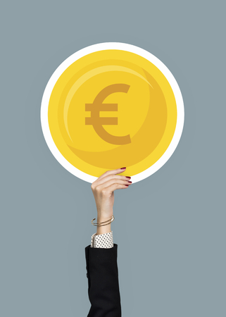 Hand holding euro gold coin clipart