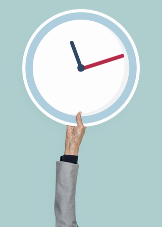Hand holding an analog clock clipart
