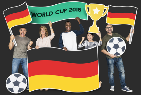Diverse football fans holding the flag of Germany