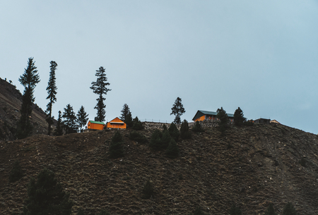 House on a mountain surrounded by trees