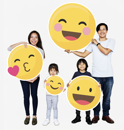 Happy family holding emoji icons