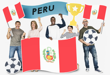 Diverse football fans holding the flag of Peru 스톡 콘텐츠