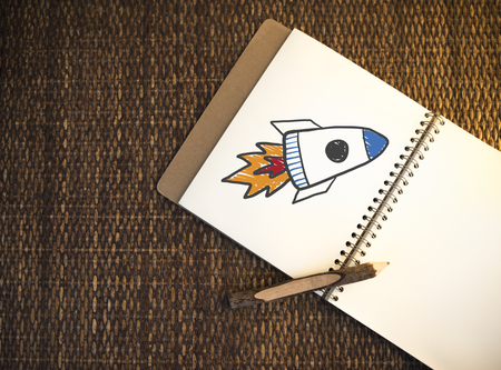 Rocket launch drawn on a notebook Stock Photo