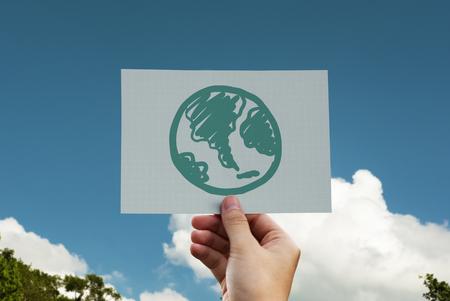 Green globe drawn on a card