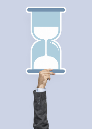 Hand holding an hourglass clipart Stockfoto