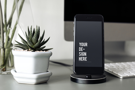 Mockup of a mobile phone on a stand Stock Photo