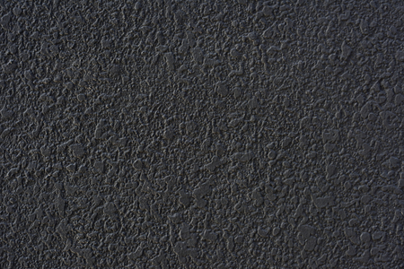 Rough black cement plastered wall texture