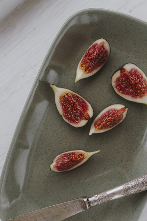 Fresh organic fig on a ceramic plate