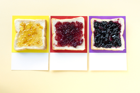 Different flavored jam on toast Stockfoto